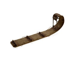 Model of long wooden sled curved up in the front and without runners (not raised above the snow surface)