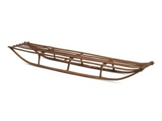 Wooden sled without rails on runners that curve up at both ends