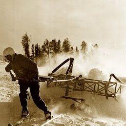 Man on skis pulling mechanical snow groomer