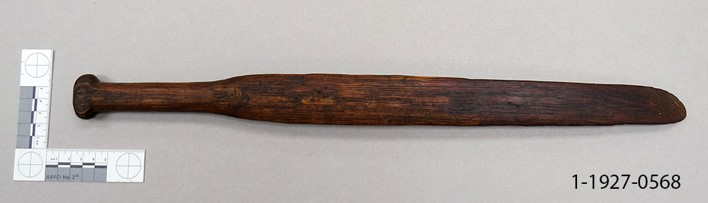 Dark brown, carved from one piece of wood, with handle, long narrow shape