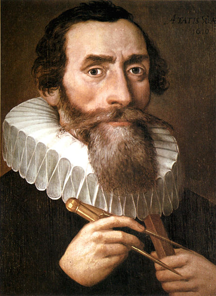 Portrait of Johannes Kepler - brown hair and beard with white collar, holding a compass