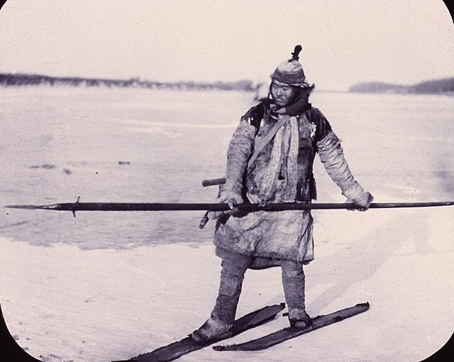 A Nanai hunter holding a spear and using one long ski and one short ski