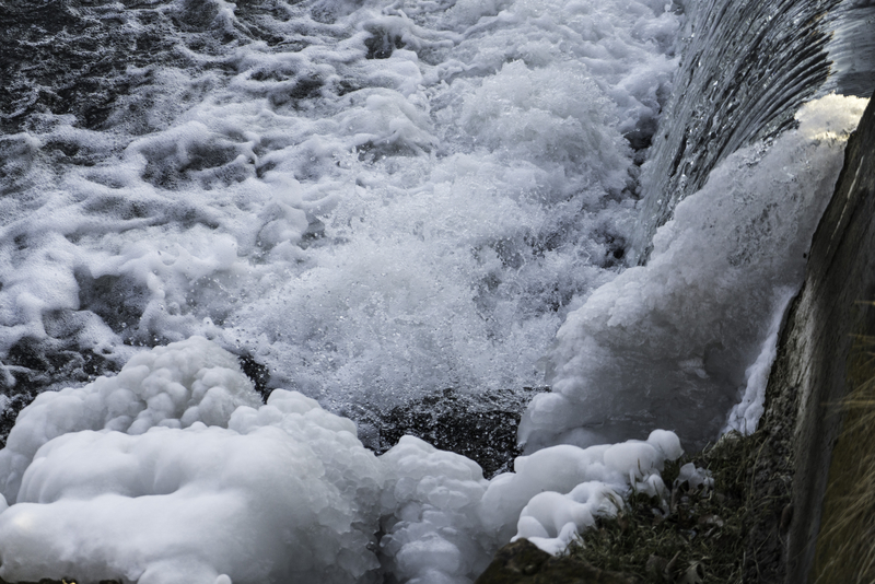 rushing water with snow on rocks