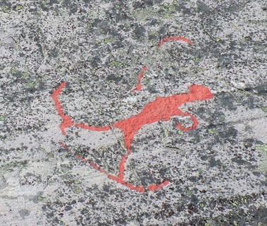 red rock painting of person on skis