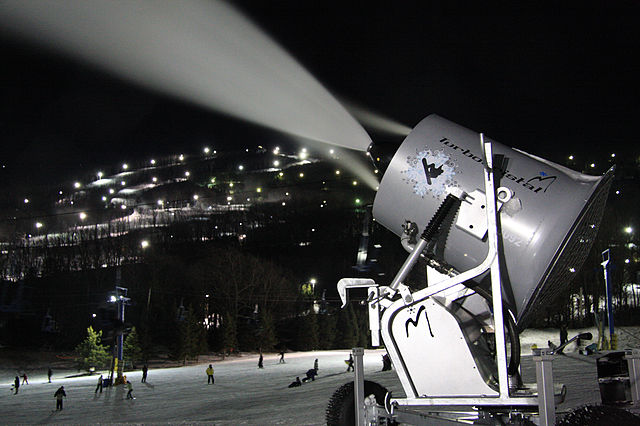 snowmaking cannon at ski resort at night