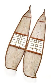 Long snowshoes with upturned toe and slightly tapered tail