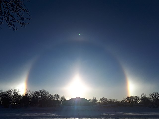 A sundog, a bright ring around the sun caused by tiny snow crystals in the air