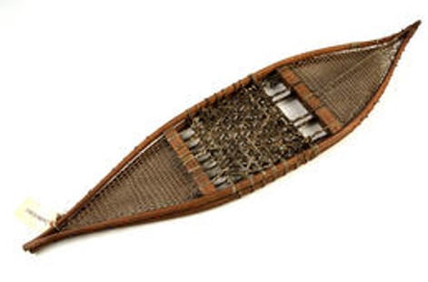 Wooden snowshoes with fine webbing, pointed at both ends