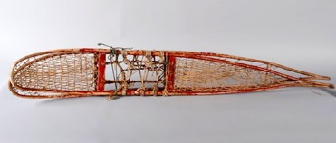 Pair of long snowshoes made of birch and animal sinew, painted red