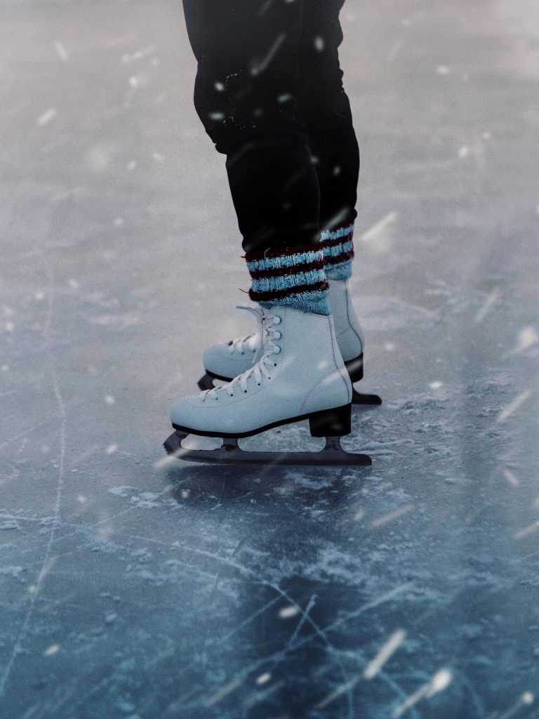 Person ice skating, photo from the knees down