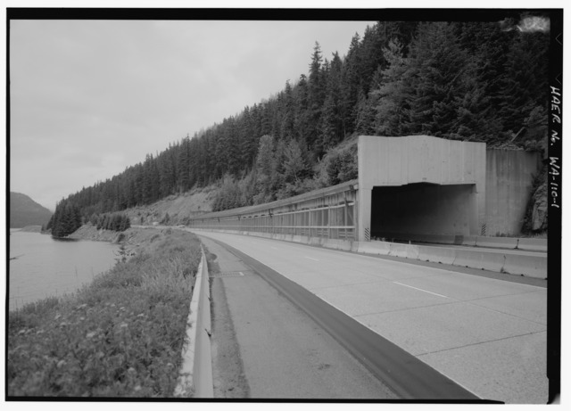 a section of highway with a snowshed structure built over one lane
